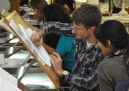 Animation tutors helping students with their drawing
