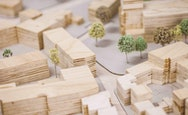 Woodblocks representing building with tiny trees