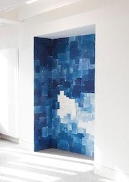 Blue paper covering a white alcove