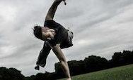 Ian Dolan balancing on one hand