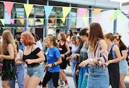 students and staff dancing at foundation bbq party