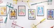 A wall covered in colourful storyboards and multicolour book stands