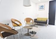 Meeting room within Student Services, features three chairs and a sofa