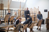 A group of students in a studio sat with easels