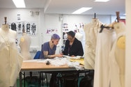 Two students working in the costume studio