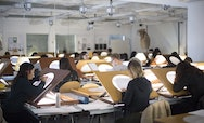 Students using lightboxes in an Animation Studio