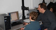 Tutor showing a student how to animate on a computer