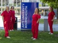 Nurses in red scrubs