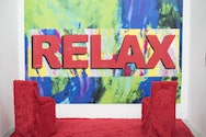 large red relax sign on colourful background