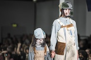 adult and child on fashion catwalk