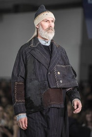 Man with beard and hat on the catwalk