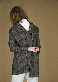 Image of lady wearing a coat backwards