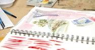 Watercolour paintings in a sketchbook
