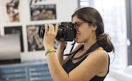 Student using a DSLR camera