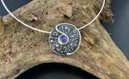 Silver pendant with a blue stone