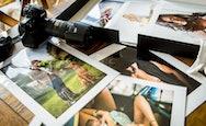 Photographs strewn out on a table
