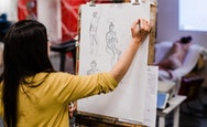 Student taking part in a life drawing session