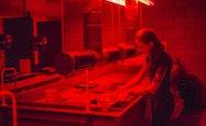 Student working in a darkroom