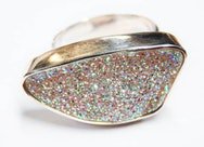 Close up of a ring with lots of very colourful stones set in it