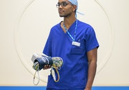 image of doctor holding cables