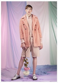 Image of a man in a pink coat