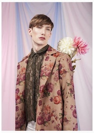 Image of a man in a floral suit jacket