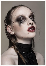 Image of a lady with smeared makeup