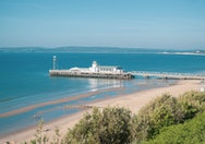 View of Bournemouth Pier jutting out into the sea on a sunny day