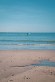 Stand up paddle boarder in the sea