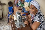 Lady sat at sewing machine