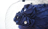 Close up of a jewelled flower feature on a hat