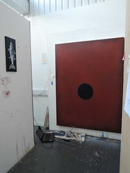 Painting with a red background and black circle