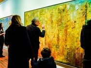 Visitors explore the Frank Bowling: Big Paintings exhibition at AUB.