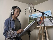 Yvonne voicing Nia in the studio