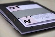 Branding material in a black folder
