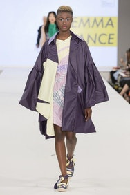 Model wearing purple jacket and colourful dress