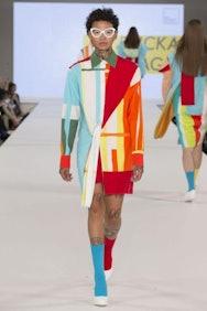 Model wearing multi coloured jacket
