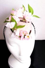 Floral fascinator on a mannequin