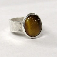 Silver ring with a brown stone