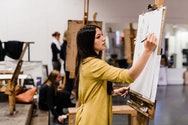 Student partaking in life drawing session