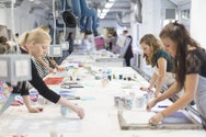 Several students working within the textiles studio