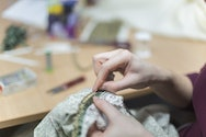 Close up of a hand sewing