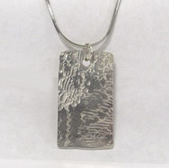 Textured silver pendant