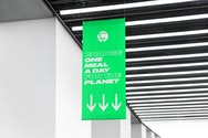 Green sign hanging from ceiling