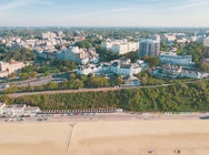 Drone view of the beach and the bournemouth skyline