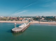 Drone view of Bournemouth Pier and the beach from the sea