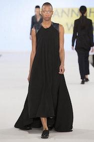 Female model wearing black dress