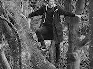 Boy standing in a tree