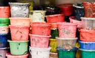 Stacked paint pots in various different colours