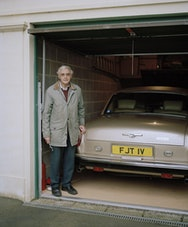Man next to vintage car